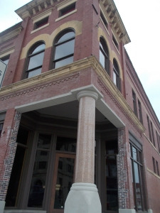 Original granite column found beneath facade at Pioneer Woman Building.