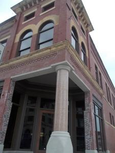 Original granite column found beneath facade at Pioneer Woman Building.